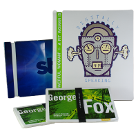 Blue Starz booklet with white band for binding on left. White booklet with cartoon robot on cover, bound with green silicone band on right. In front is a deck of green cards with George Fox printed on the front in large, white font. The cards are bound together with a black silicone band with white text on it.