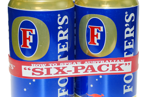 Three large blue and gold beer cans bound together with a red silicone band. The band has white text that reads